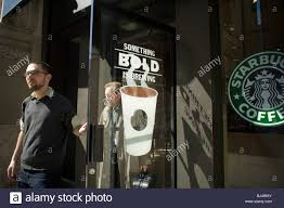 coffee shop in new york customers at a starbucks coffee shop in downtown manhattan in new