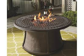 large fire pit table burnella outdoor round chat fire pit table ashley furniture homestore