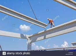 height worker is high up on concrete frame without proper safety