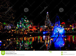 Colored Christmas Lights by Artistic Christmas Colored Lights Reflected In Pond Stock Photo