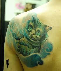 cheshire cat tattoo by jukan tattoomagz