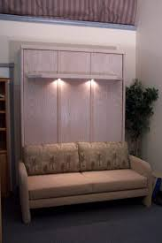 furniture light brown wooden murphy bed with brown couch having