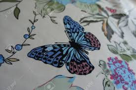 thin fabric with delicate butterfly pattern stock photo