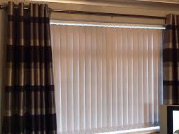 interior white vertical blinds mixed with grommet loose curtain