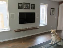 tv on gray wallcombined with wooden living mounted shelves and