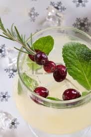 two pink mojito cocktails and christmas ornaments stock photo