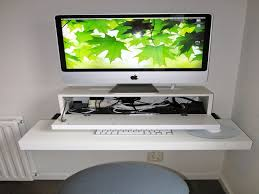 rectangle white wooden floating imac computer desk on white wall