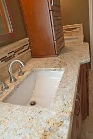 colonial gold bathroom vanity top on cherry cabinets master bath