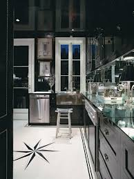 quartz countertops kitchen with black cabinets lighting flooring