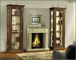 furniture white fireplace among brown wooden book cabinet with
