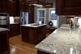 small u shaped oak wood kitchen cabinet in light brown finish