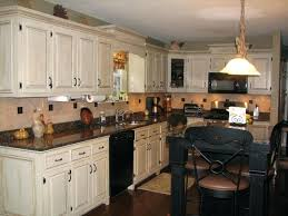 white kitchen cabinets with black island kitchen cabinets nuys shabby chic kitchen idea with white