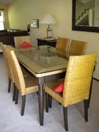 Pier One Dining Table And Chairs Pier 1 Wicker With Glass Top Dining Table Set W 6 Chairs Moving