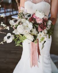 winter wedding bouquet of deep red peonies u0026 white anemones with a