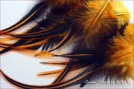 golden orange color aztec gold craft feathers wholesale golden orange color feather