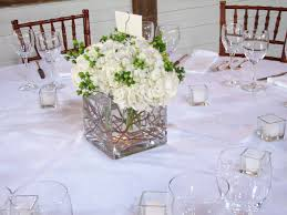 White Roses Centerpieces by White Hydrangea Centerpiece With Green Hipericum Berries And
