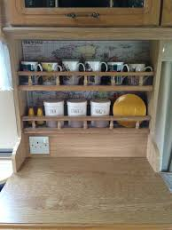 line the back of the cupboards shelves with maps how to make a