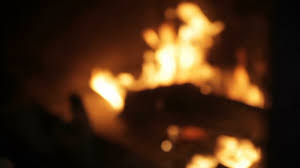 the fire is burning in the fireplace close up stock video footage