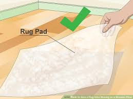 Stop Area Rug From Sliding On Carpet 3 Ways To Stop A Rug From Moving On A Wooden Floor Wikihow
