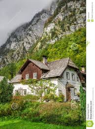 small cottage in the alps with a tree stock photo image 49363536