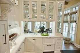 glass shelves for kitchen cabinets use glass shelves to open up space in your kansas city home