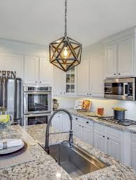 gray kitchen cabinets with black granite a kitchen goes from and dated to bright and airy