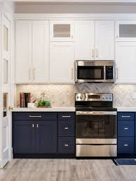 blue bottom and white top kitchen cabinets white cabinets on top blue on bottom kitchen cabinet