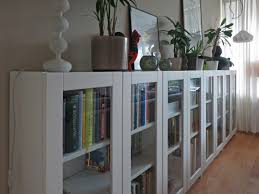 table with glass doors long white bookshelf with clear glass doors and console table top of