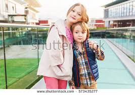 sister curls her brother hair big sister stock images royalty free images vectors shutterstock