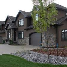 earthy tones are popular stucco home colors these days this dark