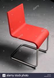 modern red kitchen modern red plastic kitchen chair on a concrete floor design by