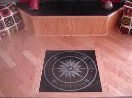 pink and black hardwood floor with granite medallion of the floor