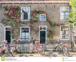 bicycles and old house in gouda holland stock photo image 57290983