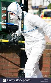 police woman scenes of crime officer forensic investigation in