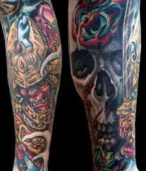 warrior and skull sleeve by paolo acuna tattoonow
