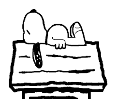 snoopy on his dog house sleeping above his dog house