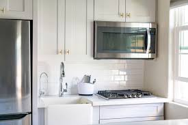 white and taupe lower kitchen cabinets 10 best kitchen cabinet paint colors