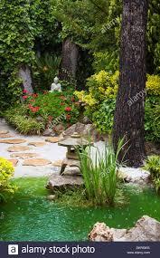 spain europe home garden rainy buddha design drops flowers garden