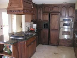 ceramic tile countertops dark oak kitchen cabinets lighting