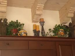 Decorations For Above Kitchen Cabinets Decorating Above Kitchen Cabinets Tuscany Decor Above Kitchen