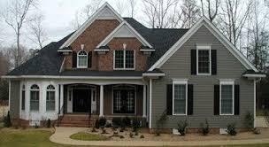 grey siding red brick black shutters bungalow exterior ideas