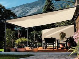 patio cream fabric porch privacy screen with black rattan chairs