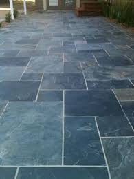 random slate tile patio with curved slate border by the