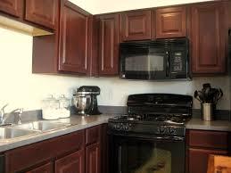 Popular Kitchen Backsplash Cherry Cabinets Black Counter Kitchen