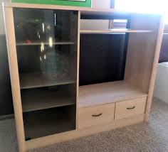 entertainment center turned kids closet armoire furniture makeover