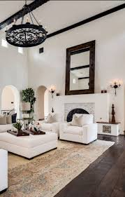 living room black brass chandelier hardwood flooring