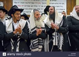 prayers for sukkot religious men in prayer at sukkot morning services in crown