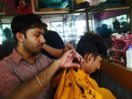 stock pictures indian hair stylists at work in small salons
