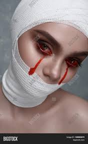 halloween makeup blood beauty woman with halloween makeup blood drops from her eyes and