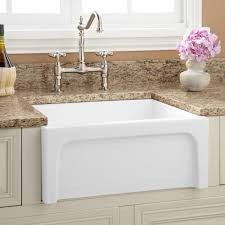 rustic white porcelain kitchen sink with curved faucet and tile
